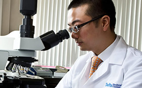 John Leung, MD a food allergist at Tufts Medical Center, conducting research.
