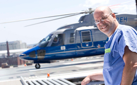 Reuben Rabinovici, MD on the helipad at Tufts Medical Center.