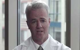A screenshot of a video of Dr. Wil Hynes, anesthesiologist at Tufts Medical Center in Boston, talking about chronic pain.