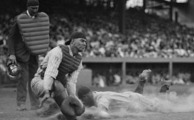 A photo of Lou Gehrig sliding into first base.