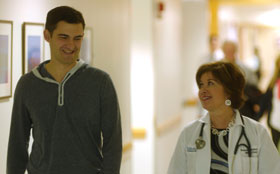 Patient and Noreen Nolan, NP speaking in the hallway