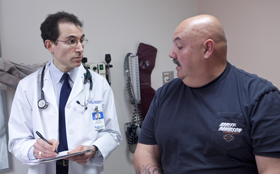 Dr. Richard Siegel of the Weight and Wellness Center at Tufts Medical Center speaks with a patient about how to join our weight loss program.