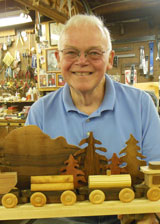 Don Swarce with his wood carving