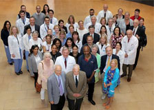 A large group of physicians standing in the shape of a heart