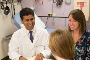 The hereditary GI cancers team at Tufts Medical Center in Boston, MA talk with a patient.