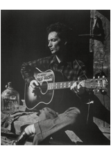 A photograph of Woody Guthrie, a piece in the Neurology, Illustrated gallery at Tufts Medical Center in Boston, MA.