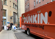 The Dunkin Donuts truck donating at Tufts MC