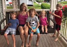 Katherine Fitzpatrick with her grandchildren on her porch swing