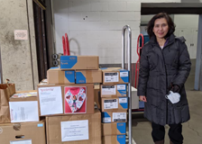 Jenny Gao, MD, bringing donations of PPE to Tufts MC