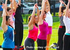 Women practicing Yoga at the Frog Pond in Boston