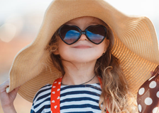 Child with a large sunhat.