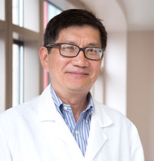 Julian Wu, MD, a neurosurgeon at Tufts MC.
