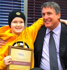 Cam Neely with a patient at Floating Hospital for Children in Boston.