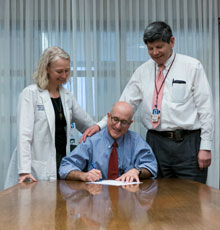 Drs. Saul Weingart, Joel Weinstock and Deb Blazey-Martin sign the 80% by 2018 Colorectal Cancer Screening Pledge.