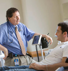 Myeloma and amyloidosis expert Ray Comenzo talks with a patient in Boston at Tufts Medical Center.