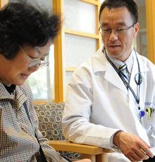A doctor and his patient at Tufts Medical Center.