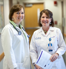 Two hematology/oncology nurse practitioners smiling at Tufts Medical Center in Boston.
