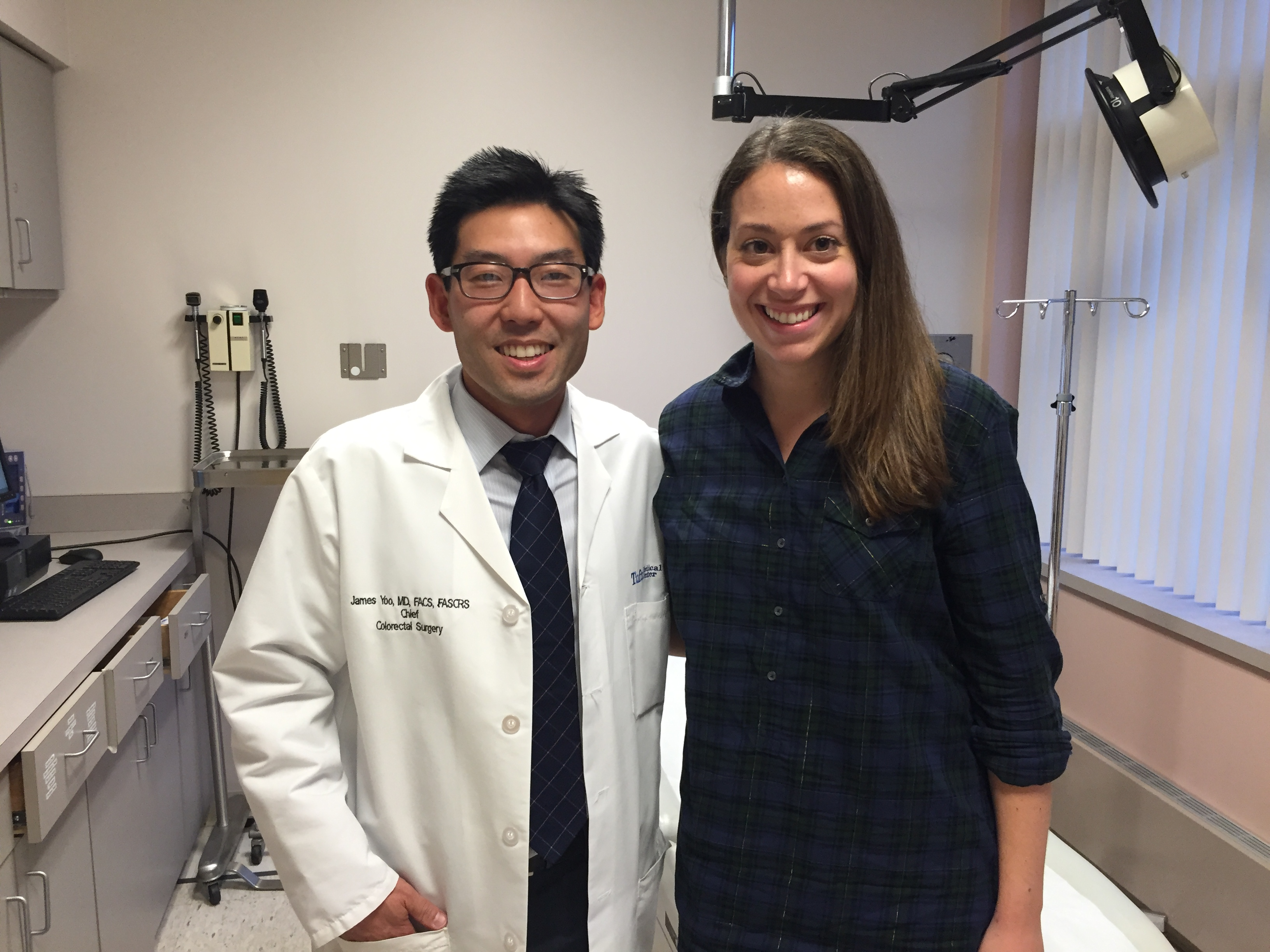 Chief of Colorectal Surgery James Yoo, MD and Jill Hadad Hawkins at a follow up appointment after her surgery.