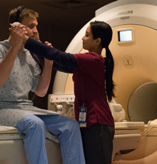 MRI technician helping a patient prepare for his MRI