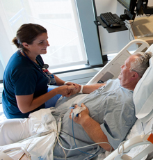 A nurse and her patient at Tufts Medical Center in Boston.