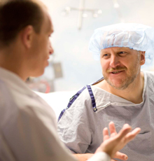 An orthopaedic surgeon preparing his patient for surgery at Tufts Medical Center in Boston.