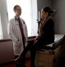 Primary Care doctor Dan Chandler, MD and his patient talk in the Boston Primary Care Office at Tufts Medical Center.