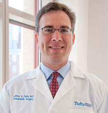 Jeffrey Zarin, MD, Chief of the Division of Arthoplasty at Tufts Medical Center in Boston, MA, shares what you need to know about knee pain in a Boston magazine post.