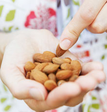 Almonds in a woman's hand