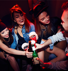 A group of teenagers drinking at a social event.