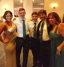 Michelle Cahill and four members of her family smiling together.
