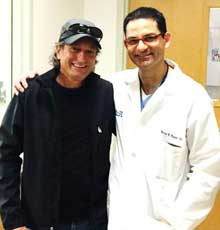 Guillermo Roman and his cardiologist, Dr. Navin Kapur at Tufts Medical Center - 5 years after his VAD implant at the Boston hospital.