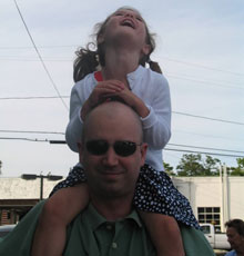 Marc Jackson with his niece on his shoulders.