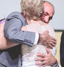 Heart transplant recipient hugging his donor's mother
