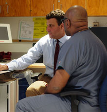 Martin Maron, MD talking with a staff member