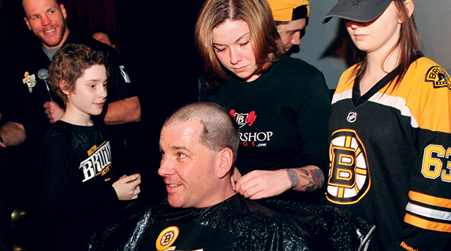Craig Williams raises money by shaving his head