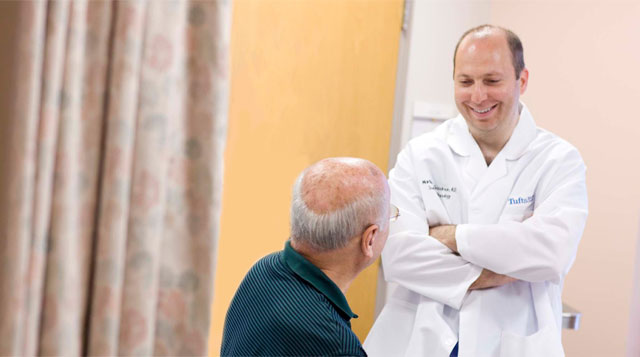 Martin Goodman, MD a doctor in the HIPEC program at Tufts Medical Center, smiling with a patient.
