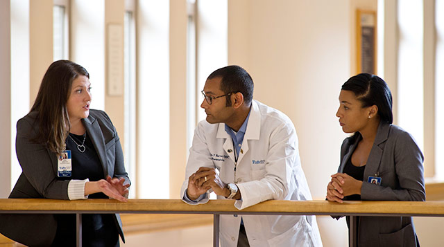 Tufts Medical Center physician liaisons meet with a doctor.