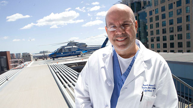 Reuven Rabinovici, MD, Chief of Trauma Surgery, with the MedFlight helicopter at Tufts Medical Center.