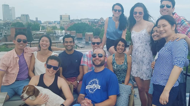 A group of residents on a rooftop in Boston