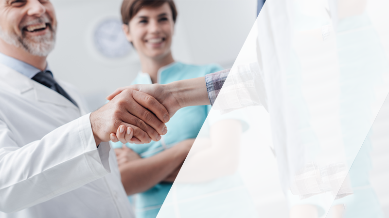 A doctor shaking the hand of a patient.