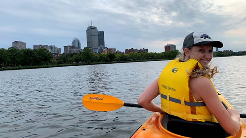 A triple board resident boating on the charles river