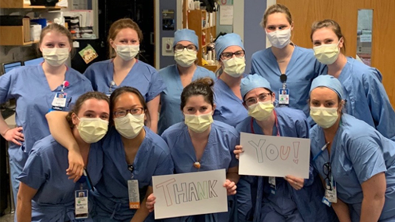 "A group of nurses holding a ""Thank You"" sign"