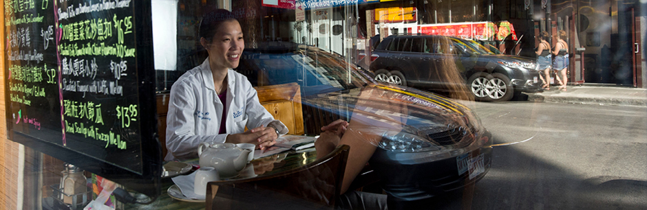 Asian doctor in the window