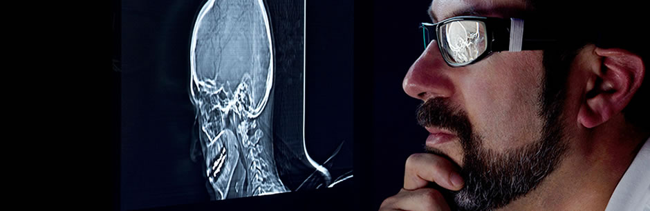 A radiologist at Tufts Medical Center reviews a patient scan.