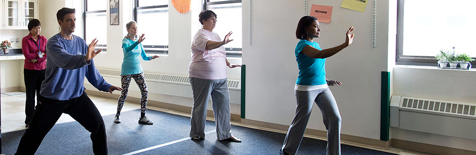 A rheumatologist at Tufts Medical Center leads a Tai Chi class to help ease fibromyalgia.